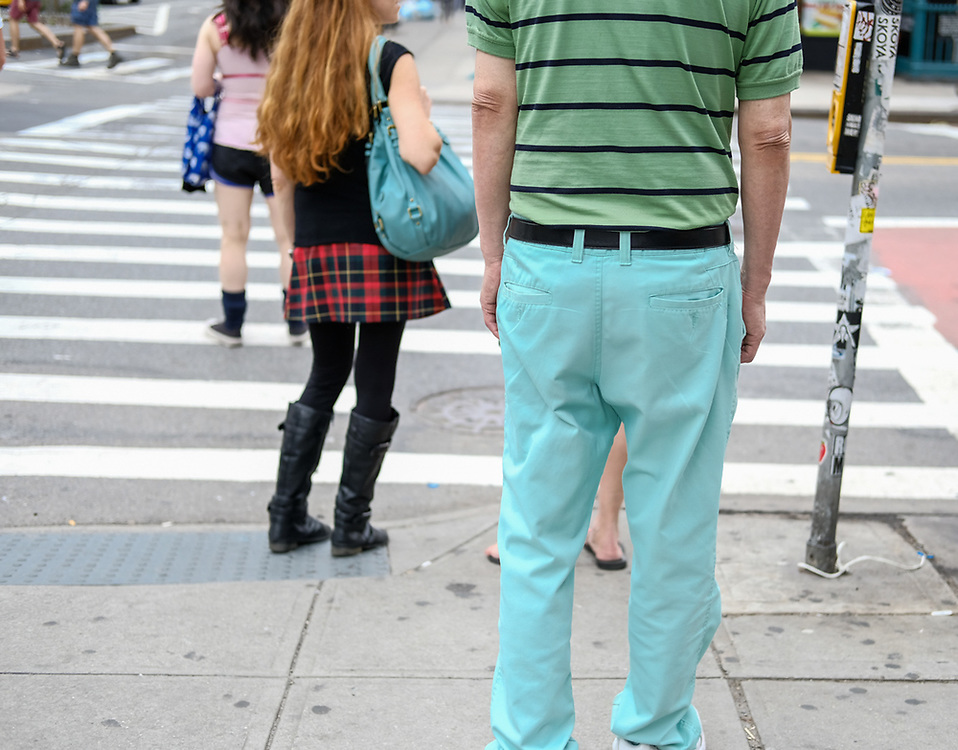 Color on the street. Man with aqua pants girl in red plaid skirt. NYC 2017