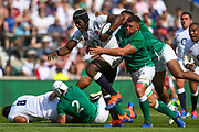 England player Mario Itoje try to break an Irish tackle in the first half during the England vs Ireland warm up fixture at Twickenham, Richmond, United Kingdom on 24 August 2019.