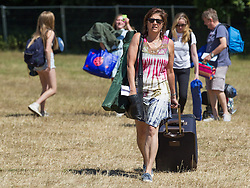 © Licensed to London News Pictures . 18/07/2013 . Suffolk , UK . Guests arrive early ahead of the Latitude music and culture festival in Henham Park , Southwold . Photo credit : Joel Goodman/LNP