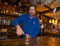 "Ray Simanson pours a glass of scotch in his bar at Tavern 27 to promote the ""Exquisite Scotch Flight"" an upcoming event later this month.  (Karen Bobotas/for the Laconia Daily Sun)"