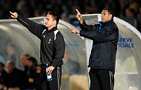 Photo: Richard Lane.<br />Wycombe Wanderers v Swindon Town. Coca Cola League 2. 26/09/2006. <br />Swindon manager, Dennis Wise and his assistant, Gus Poyet (rt) give out the orders.