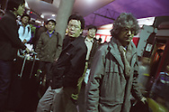 Writers (in foreground Zhang Zhe-with glasses/black jacket, and Romesh Gunesekera-grey jacket/scarf), and accompanying translators and TV crew, from the THINK UK WRITERS TRAIN,  arrive in Guangzhou train station at 6 o'clock in the morning after a 30 hour train trip from Kunming. The Think UK China Writers Train is a project, in collaboration with the British Council, to take 4 UK writers/poets and 4 Chinese writers/poets around China by train visiting 6 major cities, in 17 days, to hold talks, seminars and readings of their work.