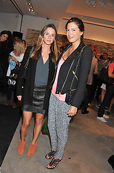 Left to right, AMANDA CROSSLEY and AMANDA FERRY at a party to celebrate the launch of the Vogue Fashion's Night Out held at Mulberry, Bond Street, London on 6th September 2012.