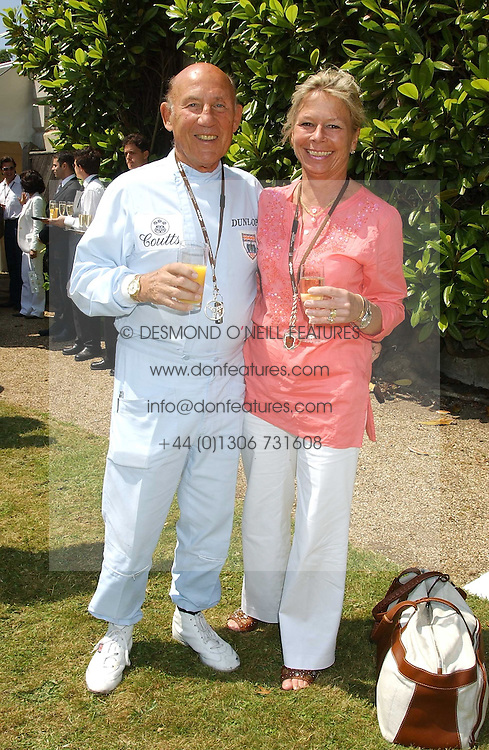 """SIR STIRLING & LADY MOSS at a luncheon hosted by Cartier at the 2005 Goodwood Festival of Speed on 26th June 2005.  Cartier sponsored the """"Style Et Luxe' for vintage cars on the final day of this annual event at Goodwood House, West Sussex. <br /><br />NON EXCLUSIVE - WORLD RIGHTS"""