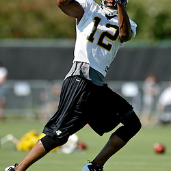 July 31, 2011; Metairie, LA, USA; New Orleans Saints wide receiver Marques Colston (12) during training camp practice at the New Orleans Saints practice facility. Mandatory Credit: Derick E. Hingle