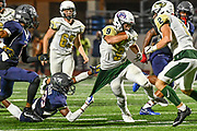 Santa Fe running back Tristan Cundiff (9) tries to break free from Manvels Trent Gordon (18) in the Mavericks 48-17 win over the Indians on Friday, Nov 3, 2017. (Photo/Olyn D. Taylor)