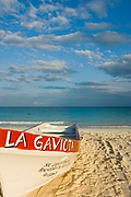 La Gaviota Red and White Lauch Boat Moored on Sand of Tulum Beach,  Mexico