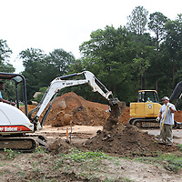 Lauren Wood | Buy at photos.djournal.com<br /> Jonas Walker mans the excavator as he and Chris Malone and Colton Jumper, far right, with Tupelo Water and Light search for the sewer connection from a nearby house as work continues Thursday morning on the West Jackson development.