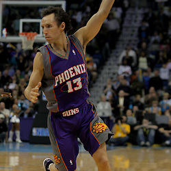 Nov 19, 2009; New Orleans, LA, USA;  Phoenix Suns guard Steve Nash (13) handles the ball during the second half against the New Orleans Hornets at the New Orleans Arena. The Hornets defeated the Suns 110-103. Mandatory Credit: Derick E. Hingle-US PRESSWIRE