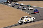 Image of porsches racing at Rennsport Reunion IV, Laguna Seca, California, America west coast