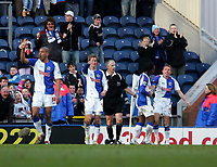 Photo: Andrew Unwin.<br />Blackburn Rovers v Middlesbrough. The Barclays Premiership. 18/03/2006.<br />Blackburn's Craig Bellamy (R) celebrates scoring his team's third goal.