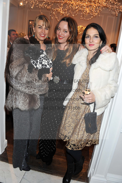 Left to right, ASSIA WEBSTER, ALICE TEMPERLEY and YASMIN MILLS at a party to celebrate thelaunch of Alice Temperley's flagship store Temperley, Bruton Street, London on 6th December 2012.