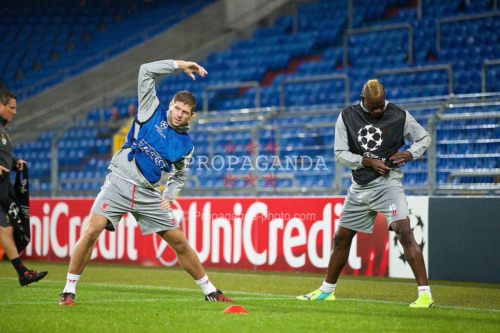 BASEL, SWITZERLAND - Tuesday, September 30, 2014: Liverpool's captain Steven Gerrard and Mario Balotelli during a training session at the St. Jakob Stadium ahead of the UEFA Champions League Group B match against FC Basel. (Pic by David Rawcliffe/Propaganda)