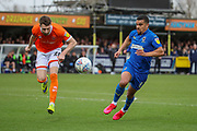 AFC Wimbledon striker Kweshi Appiah (9) battles for possession during the EFL Sky Bet League 1 match between AFC Wimbledon and Blackpool at the Cherry Red Records Stadium, Kingston, England on 22 February 2020.