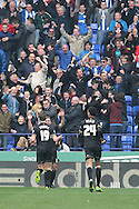 Wigan Athletic goalscorer Nick Powell celebrates in front of the Wigan fans. Skybet football league championship match , Bolton Wanderers v Wigan Athletic at the Reebok stadium in Bolton on Saturday 29th March 2014.<br /> pic by David Richards, Andrew Orchard sports photography.