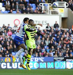 Yeovil Town's Seth Nana Ofori-Twumasi battles for a high ball with Reading's Chris Gunter - Photo mandatory by-line: Alex James/JMP - Tel: Mobile: 07966 386802 01/03/2014 - SPORT - FOOTBALL - Reading - Madejski Stadium - Reading v Yeovil Town - Sky Bet Championship