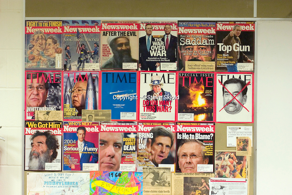 Political magazine covers on school bulletin board.  St Paul Minnesota USA