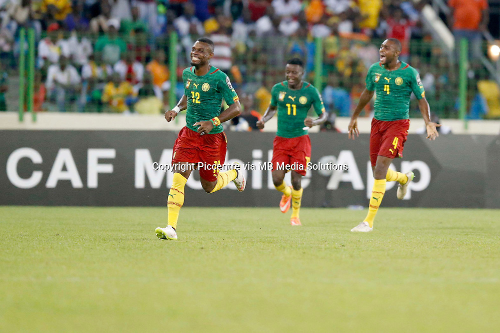 Henry Bedimo Nsame (L) and teammates celebrate his goal against Guinea during their AFCON match at the Nueva Estadio de Malabo on January 24, 2015.The match ended 1-1.Photo/Mohammed Amin/www.pic-centre.com (Equatorial Guinea)