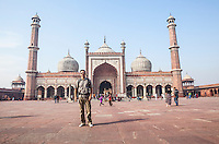 Male Tourist posing for picture in Jama Masjid mosque, in Delhi, India.