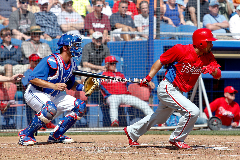 March 6, 2011; Dunedin, FL, USA; Philadelphia Phillies center fielder Shane Victorino (8) hits a two run single during the third inning of a spring training game against the Toronto Blue Jays at Florida Auto Exchange Stadium. Mandatory Credit: Derick E. Hingle-US PRESSWIRE