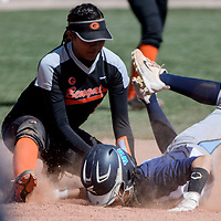 Gallup Bengal LeiLani Yermen (5) tags out Window Rock Scout Danesha Henry (15) as she dives into second base Tuesday at Gallup High School.