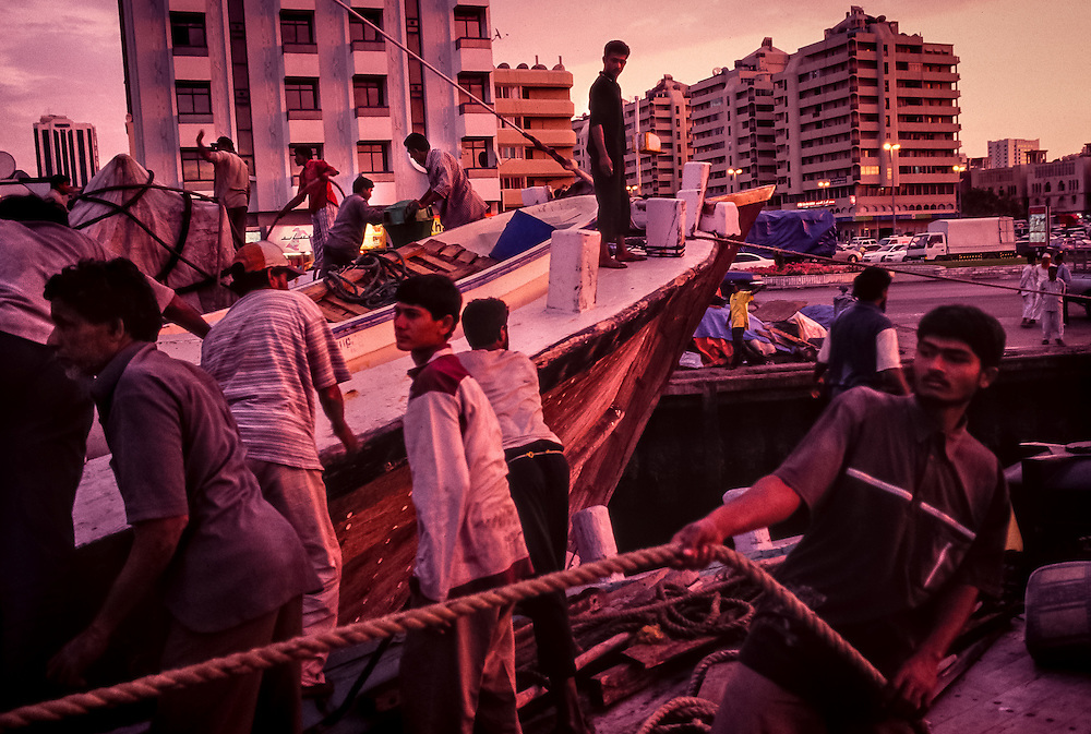 Sharjah, United Arab Emirates: Sailors reposition their dhows along the corniche