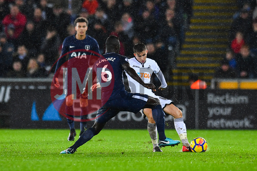 Tom Carroll of Swansea City under pressure from Davinson Sanchez of Tottenham Hotspur - Mandatory by-line: Craig Thomas/JMP - 02/01/2018 - FOOTBALL - Liberty Stadium - Swansea, England - Swansea City v Tottenham Hotspur - Premier League