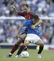 Fotball<br /> Kvalifisering til UEFA Champions League<br /> 25.08.2004<br /> Foto: SBI/Digitalsport<br /> NORWAY ONLY<br /> <br /> Glasgow Rangers v CSKA Moskva<br /> <br /> Rangers Nacho Novo is tackled by Moscow's Elvir Rahmic