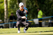 Swedish golf professional Robert Karlsson  lines his putt up during the BMW PGA Championship at the Wentworth Club, Virginia Water, United Kingdom on 26 May 2016. Photo by Simon Davies.