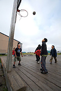 Children playing basketball in Newtok, Alaska. 2008