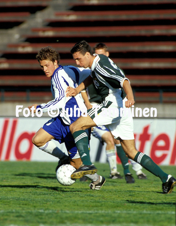 01.06.2001, Ratina Stadium, Tampere, Finland. UEFA under-21 European Championship qualifying match, Finland v Germany. .Paulus Roiha (Finland) v Michael Zepek (Germany).©JUHA TAMMINEN