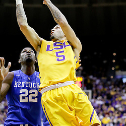 Jan 5, 2016; Baton Rouge, LA, USA; LSU Tigers guard Josh Gray (5) shoots over Kentucky Wildcats forward Alex Poythress (22) during the first half of a game at the Pete Maravich Assembly Center. Mandatory Credit: Derick E. Hingle-USA TODAY Sports