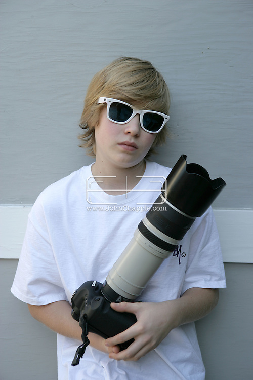 12th November 2007. West Hollywood, California. Pint-sized paparazzi. As the youngest paparazzi photographer working in Hollywood, 14-year-old Austin Visschedyk is often working alongside photographers old enough to be his father. The teenager has photographed some of the biggest tabloid celebrities in the business, including Britney Spears, Paris Hilton and Tara Reid. The home-schooled young photographer is often seen outside the swanky Beverly Hills eateries and nightclubs, using the very latest camera equipment worth thousands of dollars..PHOTO © JOHN CHAPPLE / REBEL IMAGES.tel 310 570 9100