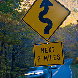 A narrow road (VT 108) winds its way through Smuggler's Notch near Stowe, Vermont.  Smuggler's Notch State Park. Fall.