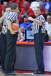 22 December 2013:  referees Brent Hampton, Mark Whitehead and Mike Stuart gather around the replay screen during an NCAA  mens basketball game between the Blue Demons of DePaul falling to  the Illinois State Redbirds 69-64 in Redbird Arena, Normal IL
