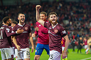 Aidan Keena (#35) of Heart of Midlothian FC salutes the crowd after he scores the winning penalty during the penalty shoot out at the end of Betfred Scottish Football League Cup quarter final match between Heart of Midlothian FC and Aberdeen FC at Tynecastle Stadium, Edinburgh, Scotland on 25 September 2019.