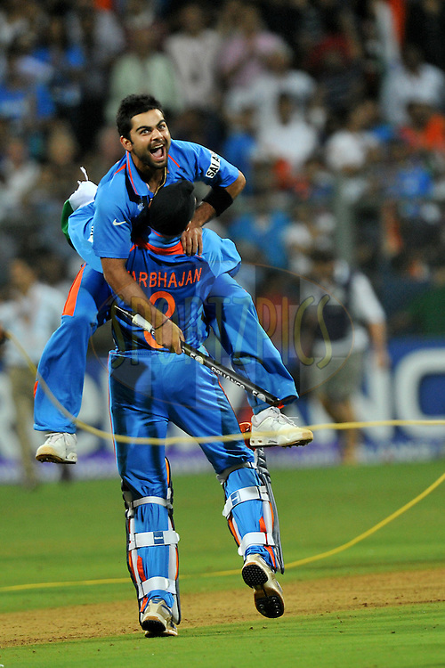 Harbhajan Singh of India and Virat Kohli of India celebrate after winning the  ICC Cricket World Cup Final held at the Wankhede Stadium in Mumbai on the 2nd April 2011..Photo by Pal Pillai/BCCI/SPORTZPICS...