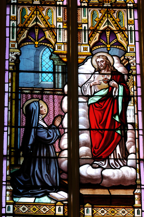 A stained glass window at Our Lady of the Lake Church in Ashland depicts Jesus revealing his sacred heart to Margaret Mary Alacoque.