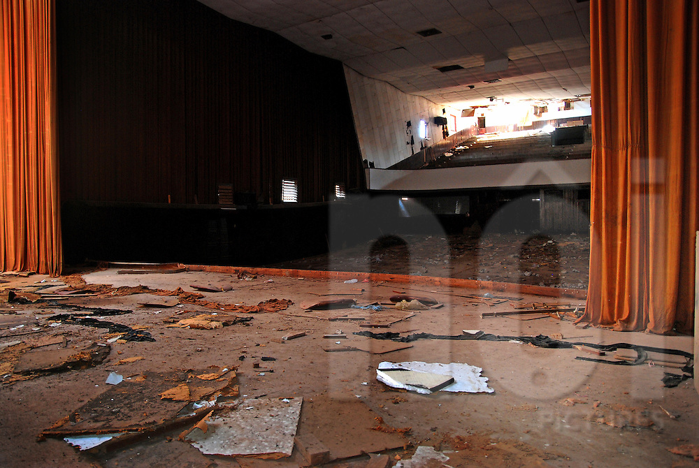 Stage of the abandoned cinema of Bouasavanh, Vientiane, Laos, Asia. Red curtains go down from ceiling