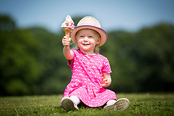 © Licensed to London News Pictures. 18/07/2017. Leeds UK. 2 year old Scarlet enjoys an ice cream at Temple Newsam park in Leeds this morning as temperatures hit 24 celsius in Yorkshire. Photo credit: Andrew McCaren/LNP