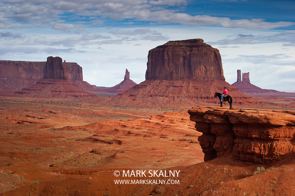 MONUMENT VALLEY, UTAH - NOVEMBER 20: An unidentified navajo man rides a horse on November 20, 2010 at Monument Valley, Utah, USA. Monument Valley is a navajo reservation area.