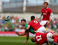 Rugby Union - 2019 pre-Rugby World Cup warm-up (Guinness Summer Series) - Ireland vs. Wales<br /> <br /> Robbie Henshaw (Ireland) offloads while tackled by Tomos Williams (Wales) and Hadleigh Parkes (Wales) at The Aviva Stadium.<br /> <br /> COLORSPORT/KEN SUTTON