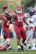 FAYETTEVILLE, AR - NOVEMBER 22:  Trey Flowers #86 of the Arkansas Razorbacks come up with a fumble during a game against the Ole Miss Rebels at Razorback Stadium on November 22, 2014 in Fayetteville, Arkansas.  The Razorbacks defeated the Rebels 30-0.  (Photo by Wesley Hitt/Getty Images) *** Local Caption *** Trey Flowers