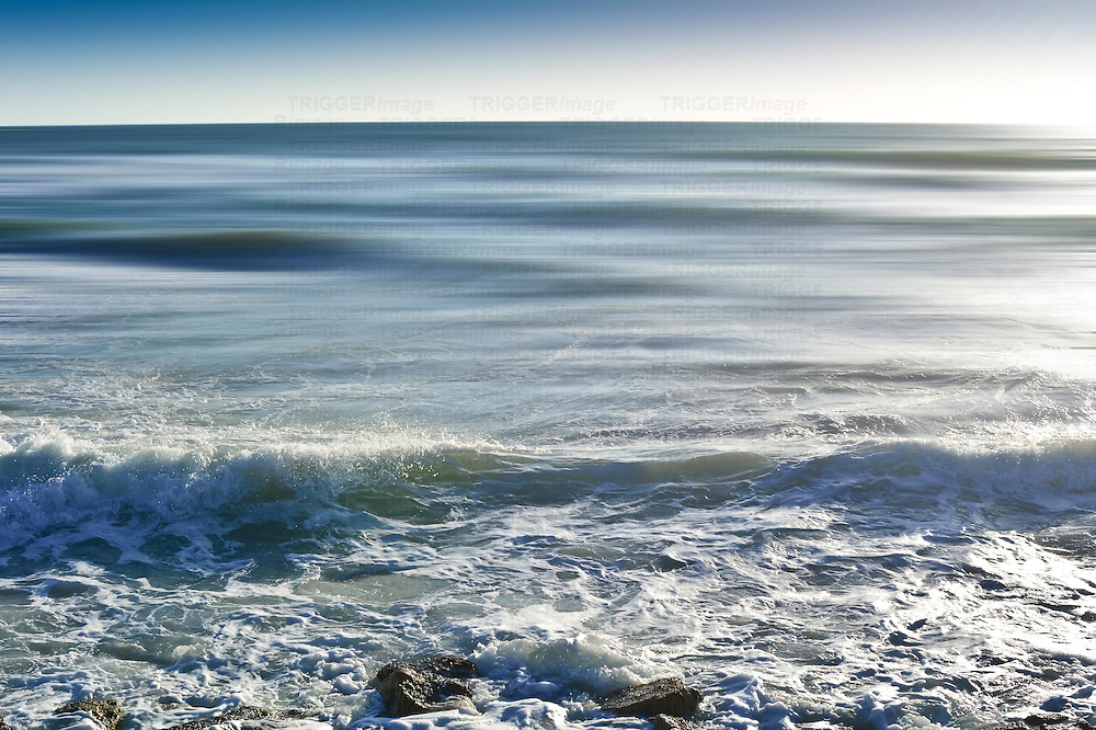 Conceptual beach scene with waves