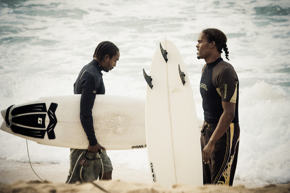 Two African American surfers get ready to surf Banzai Pipeline, North Shore, Oahu, USA.