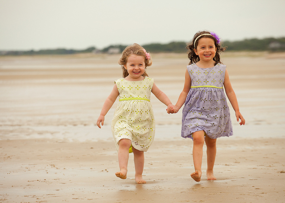 Portrait of two young girls walking along Cape Cod Bay in Brewster