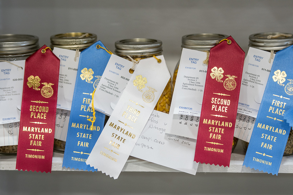 Timonium, Maryland - First and Second place jars of corn with entry tags sit along a ledge at the 2016 Maryland State Fair.