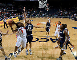 Virginia Cavaliers G Paulisha Kellum (3) goes up for a shot.  The Virginia Cavaliers women's basketball team fell to the #14 ranked George Washington Colonials 70-68 at the John Paul Jones Arena in Charlottesville, VA on November 12, 2007.