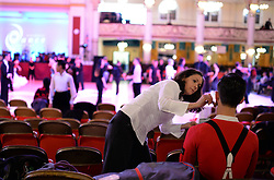 © Licensed to London News Pictures. A woman puts make up on a competitor at the British Ballroom dance championships at the Winter Gardens in Blackpool 26-05-2015. The first Blackpool Dance Festival was held  in 1920 now has 60 countries represented with total number of 2,950 couples competing. . Photo credit: Nigel Roddis/LNP