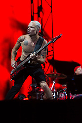 "© Licensed to London News Pictures. 14/06/2014. Isle of Wight, UK.   Red Hot Chili Peppers performing live at Isle of Wight Festival .   In this picture - Flea .  Red Hot Chili Peppers are an American rock band composed of members Anthony Kiedis (lead vocals),Michael ""Flea"" Balzary  (bass)<br /> Chad Smith (drums), Josh Klinghoffer (guitar, keyboards, backing vocals).   Isle of Wight festival is an annual music festival that takes place on the Isle of Wight. Photo credit : Richard Isaac/LNP"